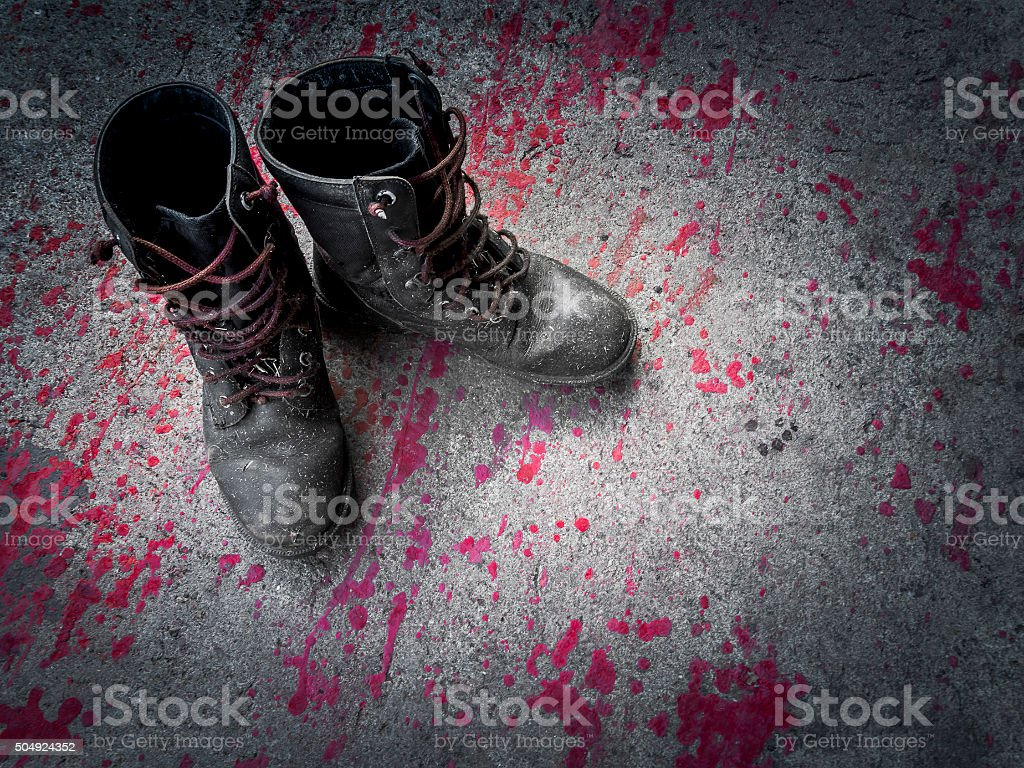 Dirty Leather Combat Boot. stock photo