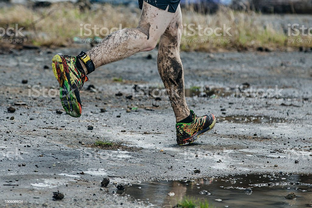 dirty legs men runner stock photo