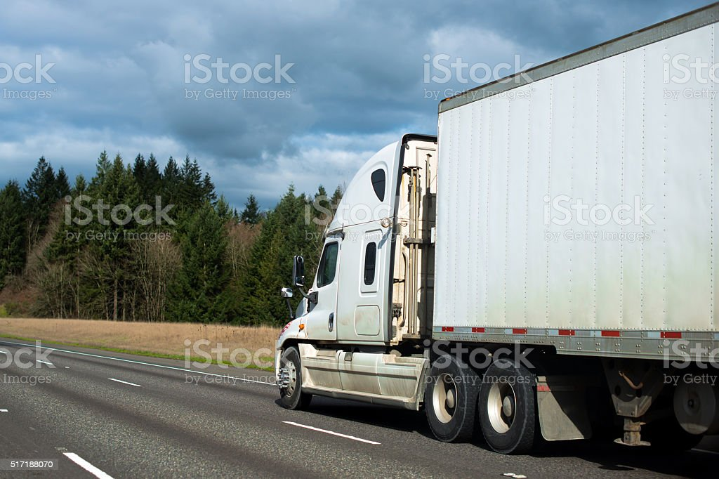 Dirty modern semi truck big rig trailer dry van stock photo