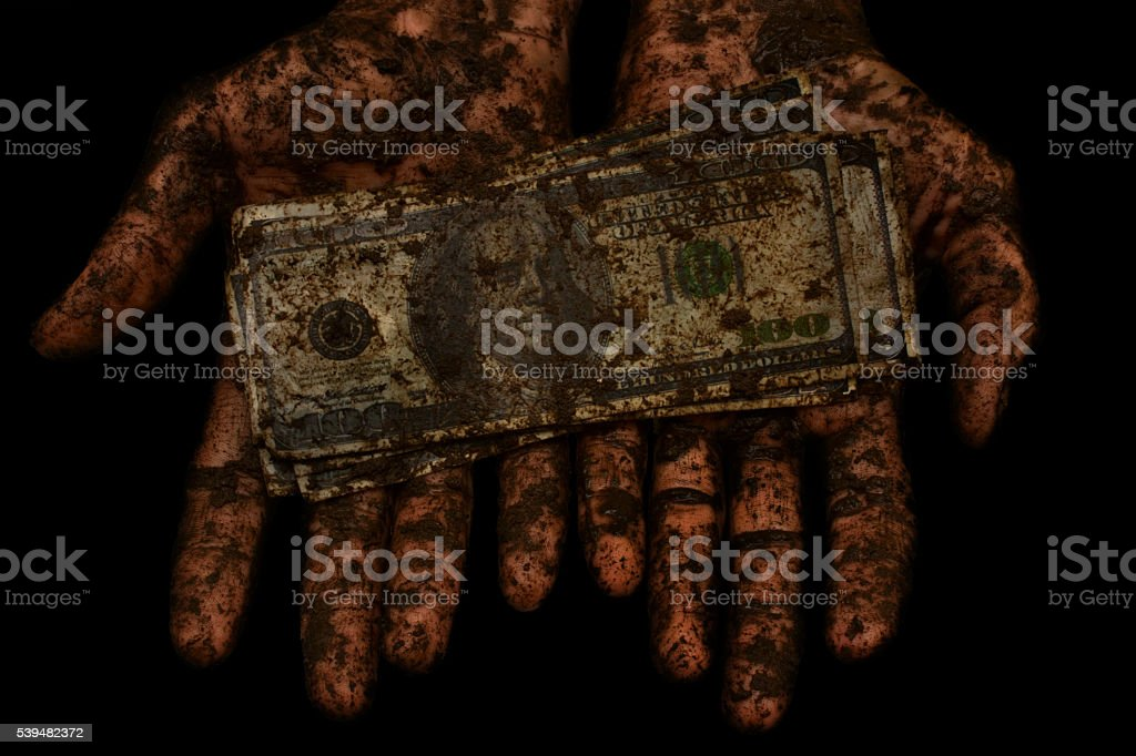 dirty money is not clean hands stock photo