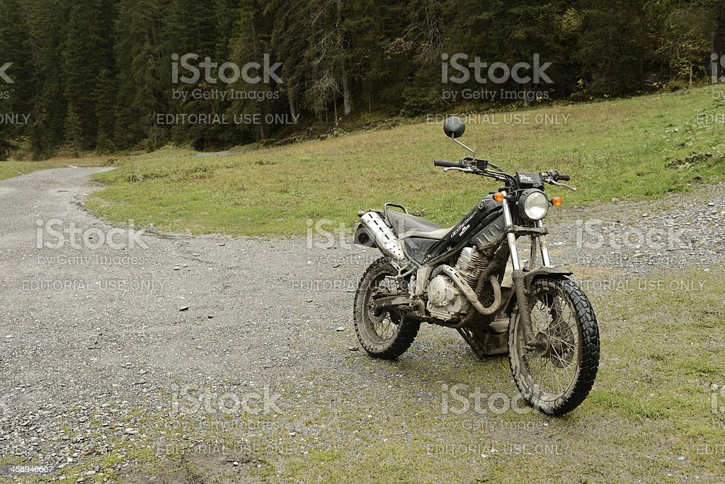 Dirty Motorcycle in the Alps royalty-free stock photo