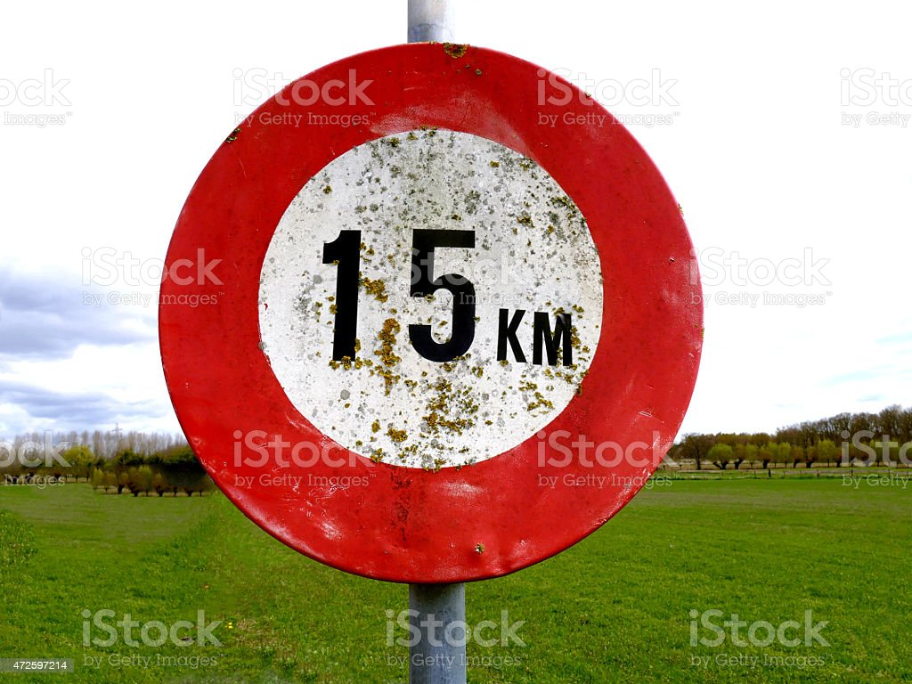 Dirty old 15 km per hour speed sign stock photo