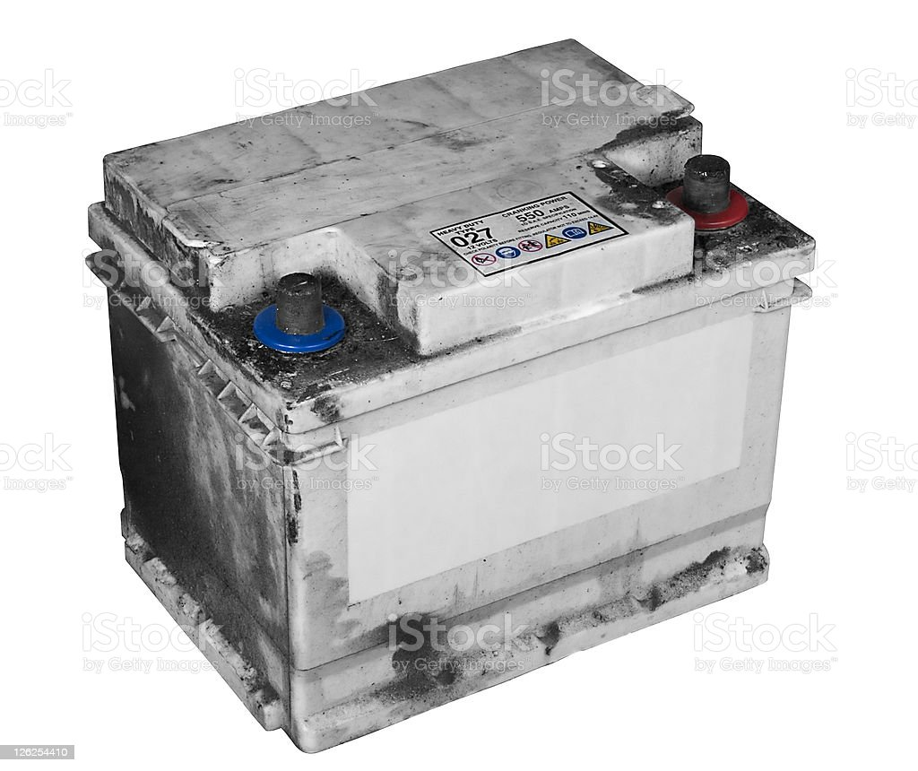 Dirty old car battery isolated on white stock photo