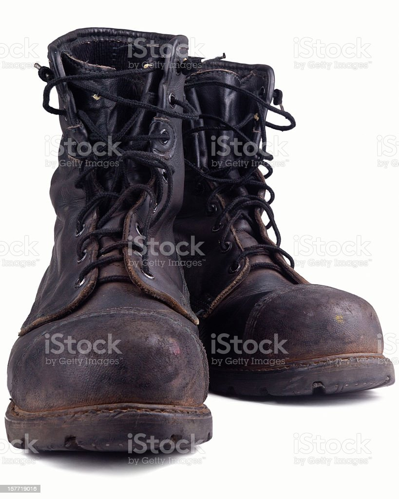 dirty old combat boot stock photo