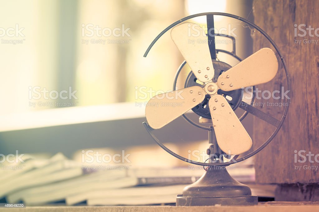 Dirty old vintage metal fan in retro style stock photo