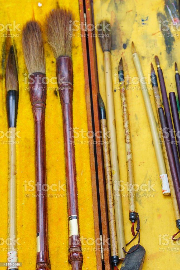 Dirty paintbrushes stock photo