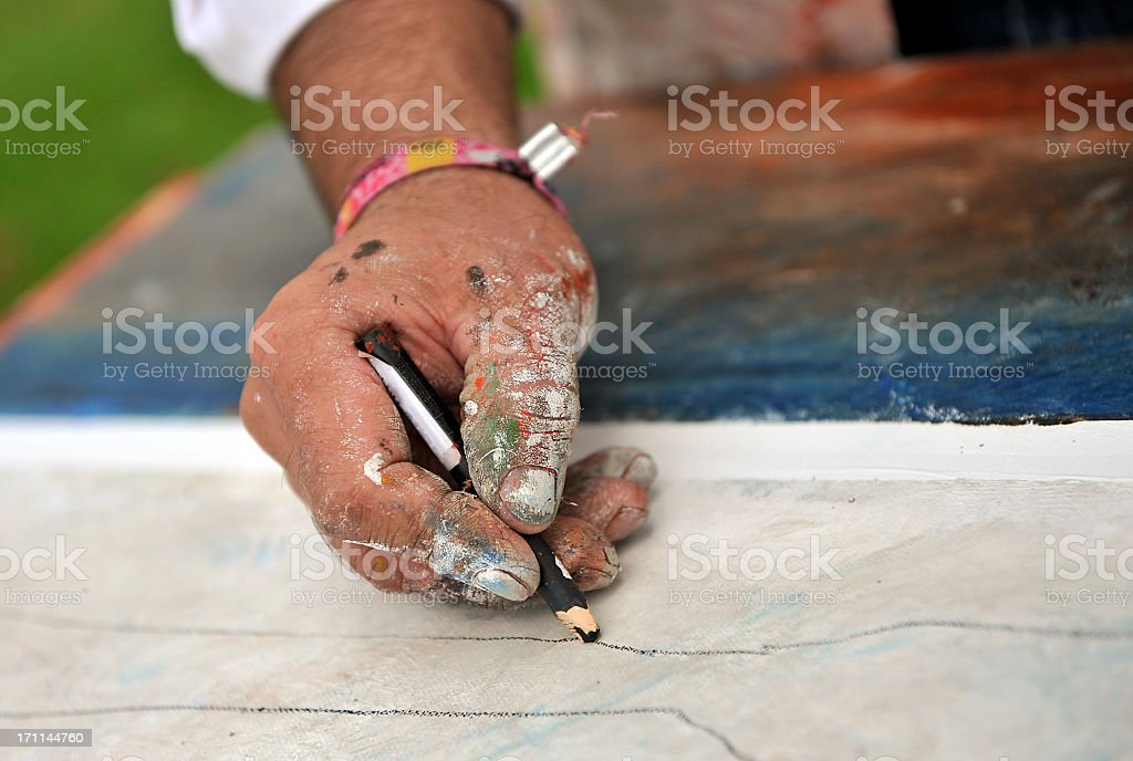 Dirty painter hand with pencil royalty-free stock photo