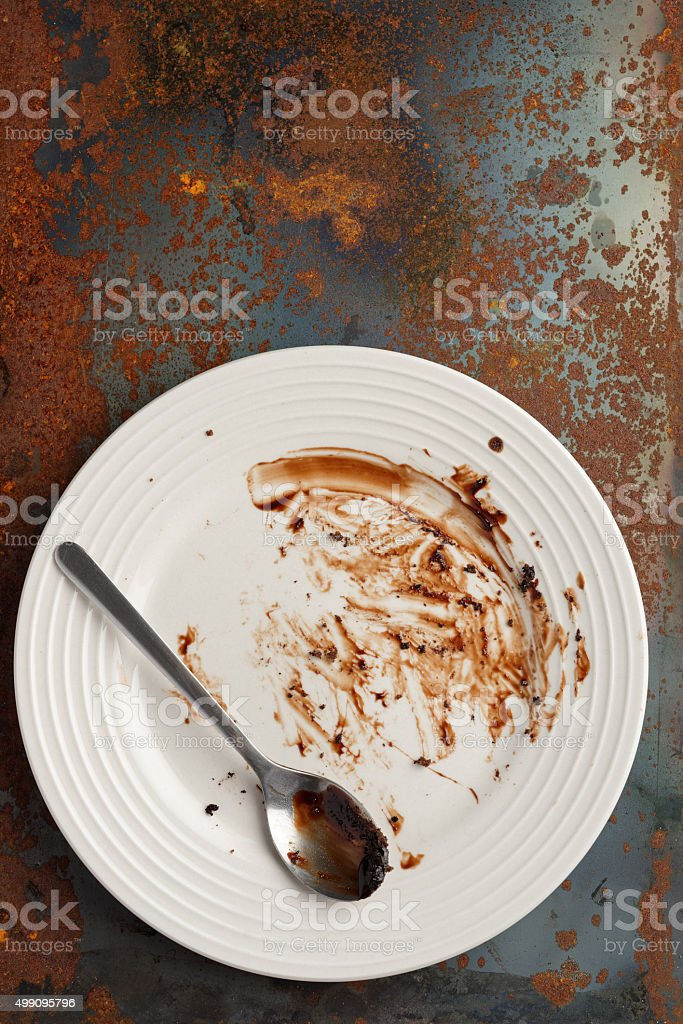 Dirty plate on a grunge background stock photo