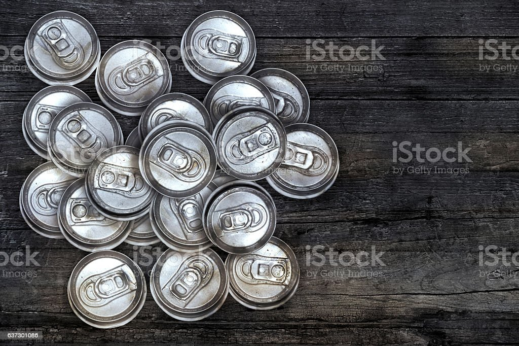 dirty recycle aluminum drink cans on wood background. stock photo
