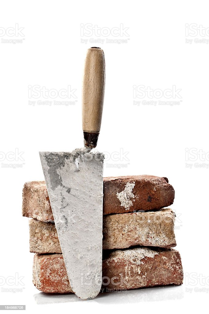 Dirty Red Brick and Trowel stock photo