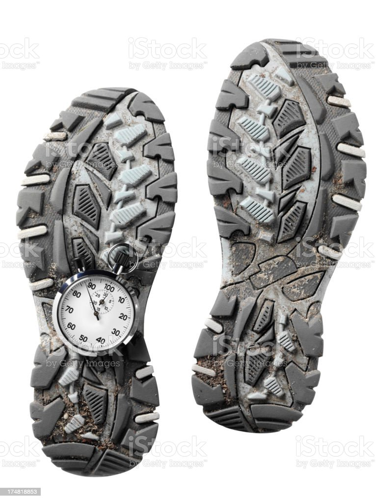 Dirty Running Shoes with a Stopwatch royalty-free stock photo