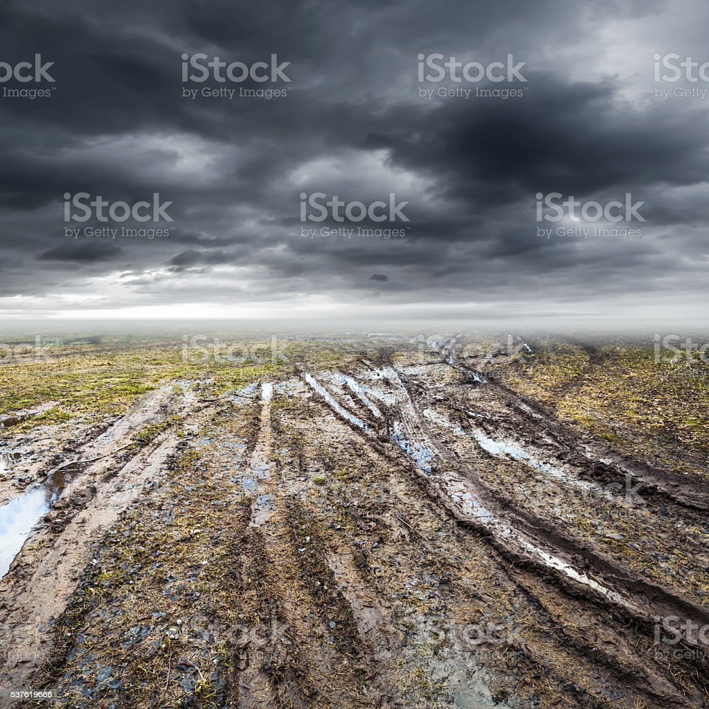 Dirty rural road with puddles and mud stock photo