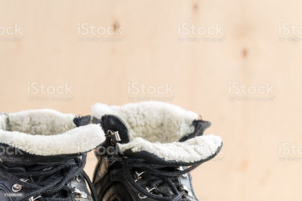 Dirty shoes after hiking on rough terrain. stock photo