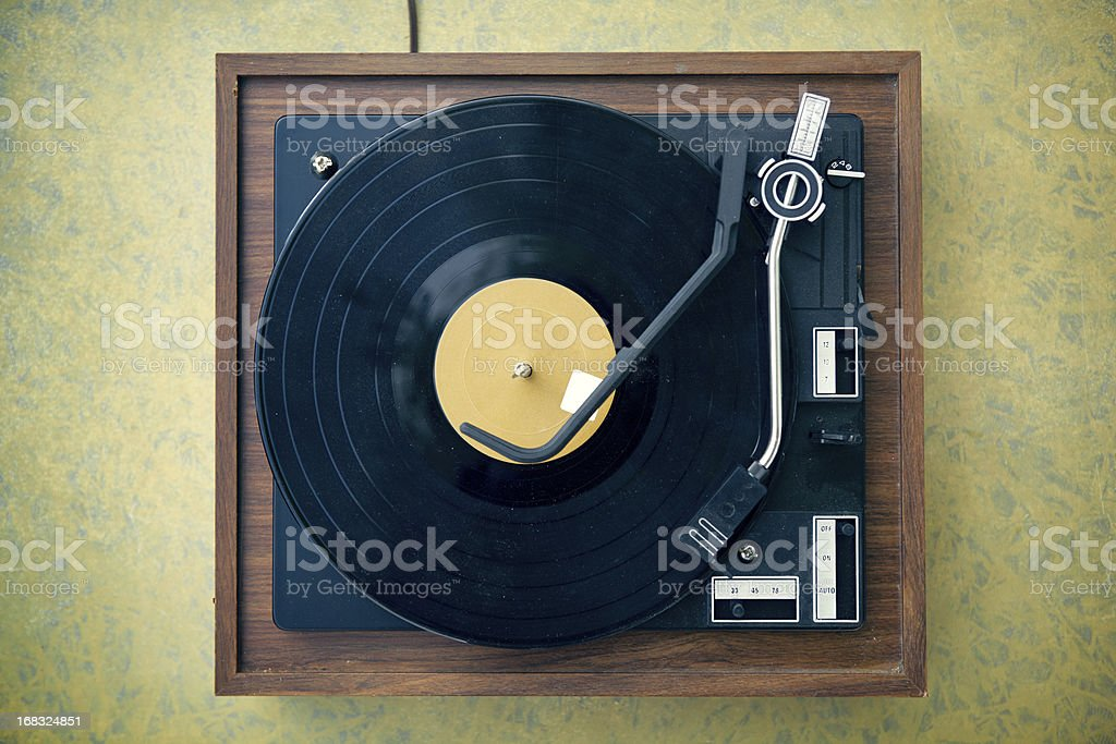 Dirty Turntable and Record on Formica Background royalty-free stock photo