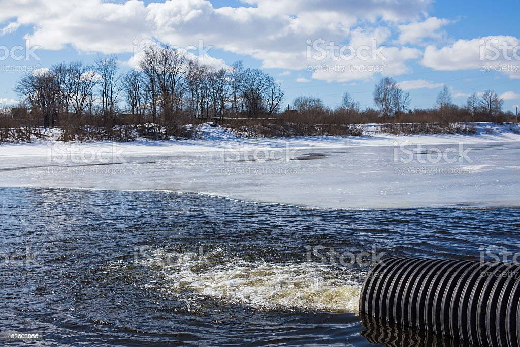 Dirty water discharged into river stock photo
