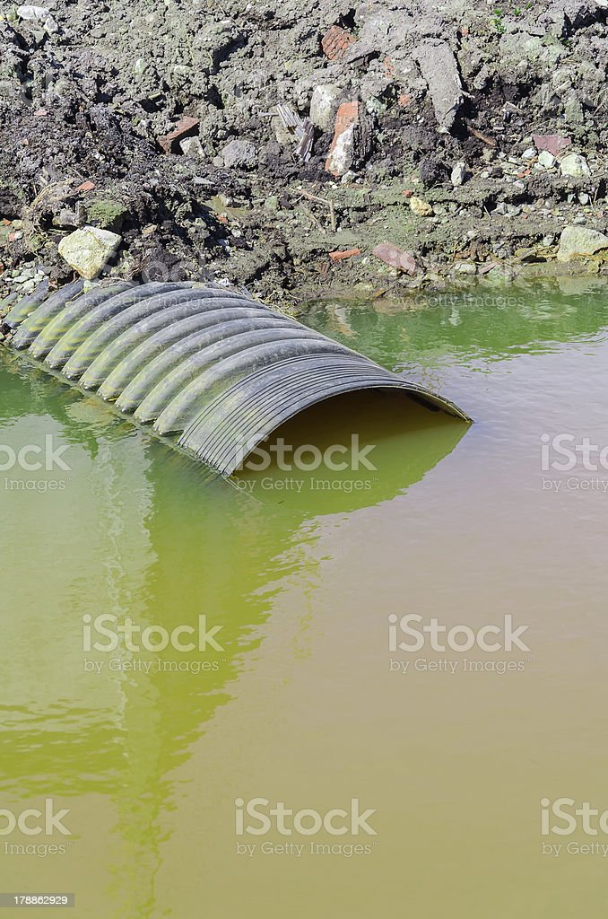 Dirty water stems from the pipe royalty-free stock photo