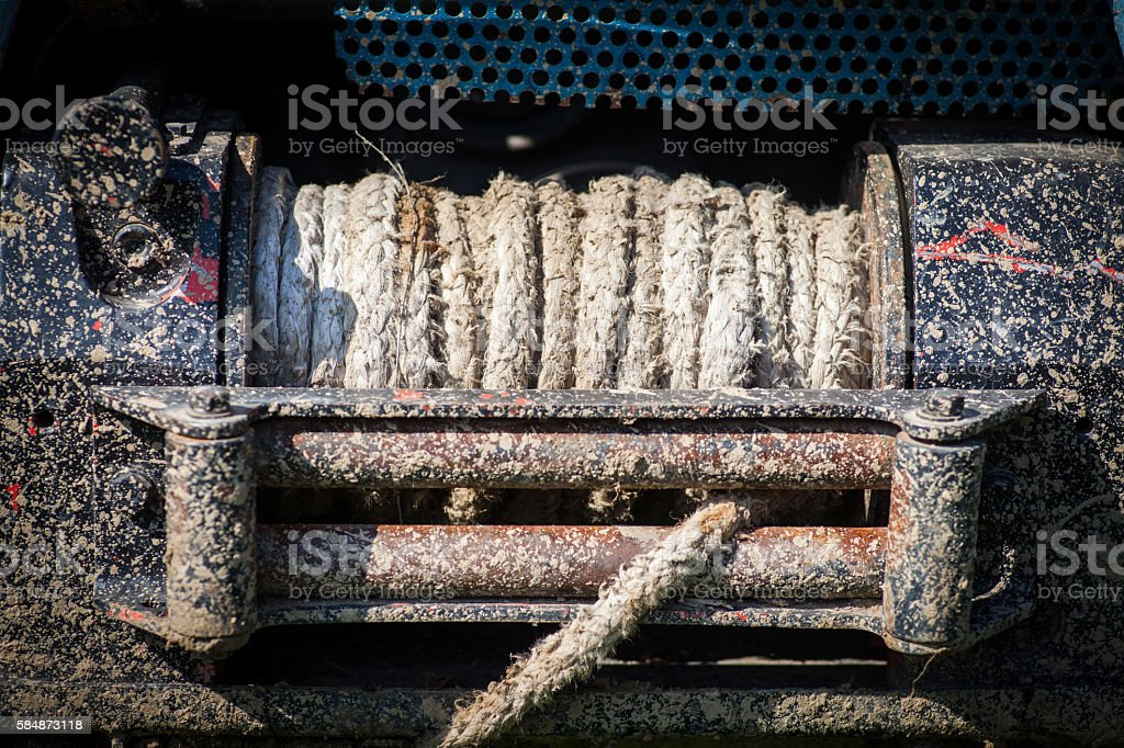 Dirty winch on car stock photo