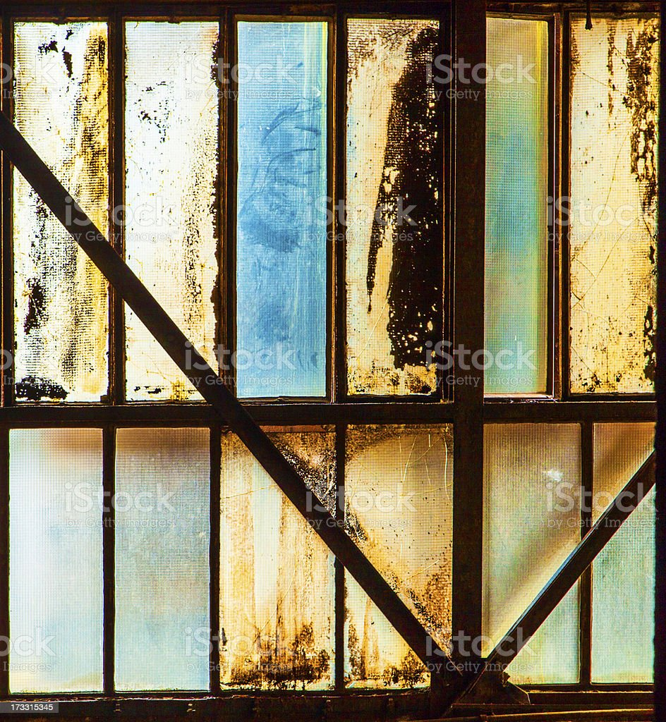 dirty window of old iron works plant royalty-free stock photo