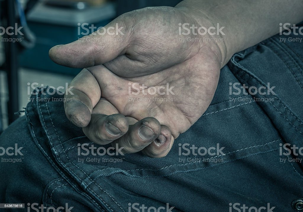 Dirty worker hand stock photo