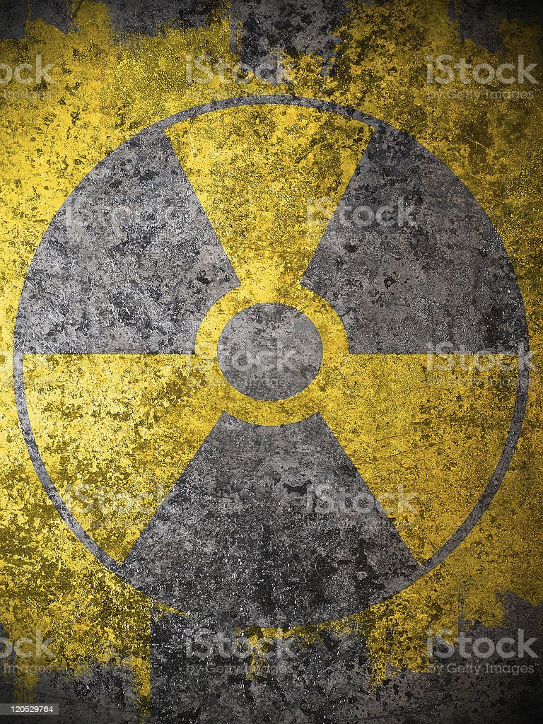 dirty yellow nuclear warning symbol stock photo