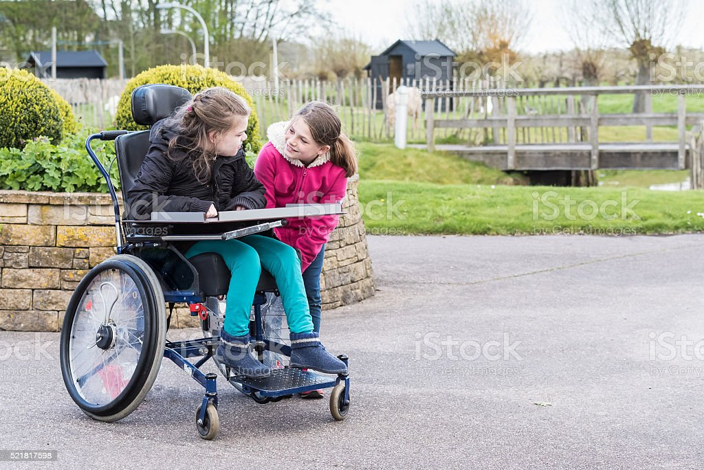Disability a disabled person   together with her sister stock photo