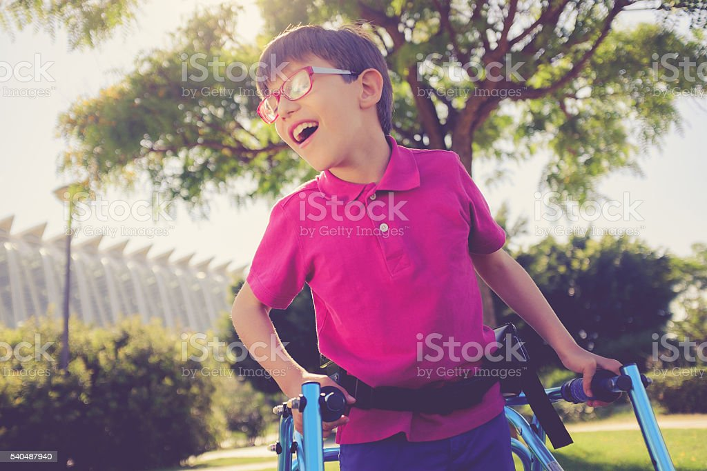 Disability child, walking sticks, cerebral palsy, smiling stock photo