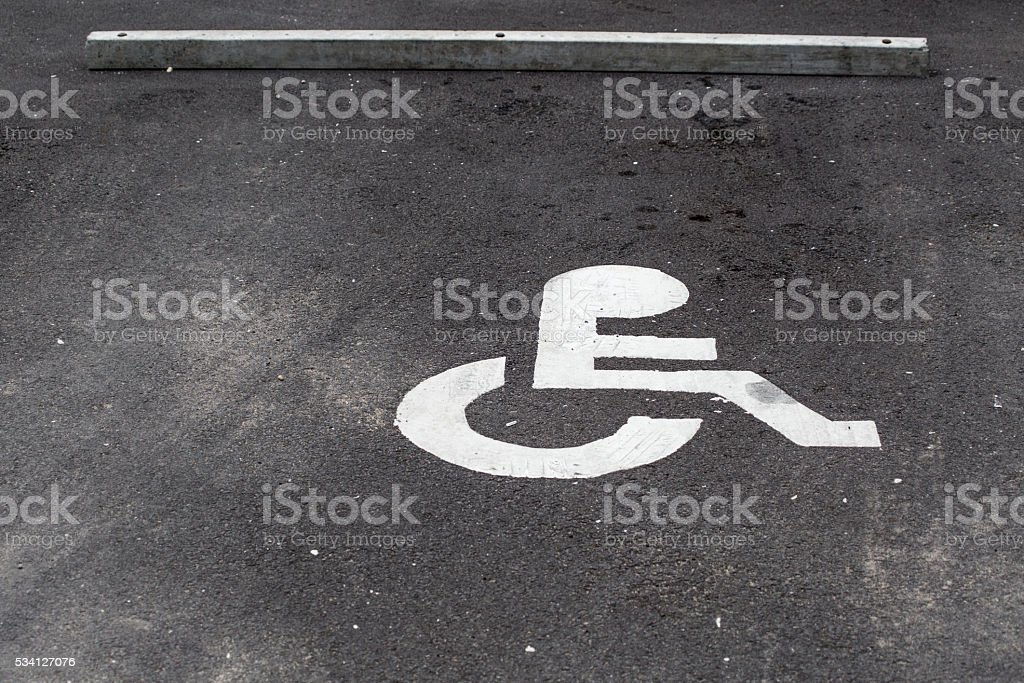 disability parking lot, disability sign on asphalt road background. stock photo