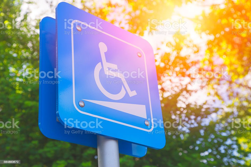 Disability slope or wheelchair ramp sign. stock photo
