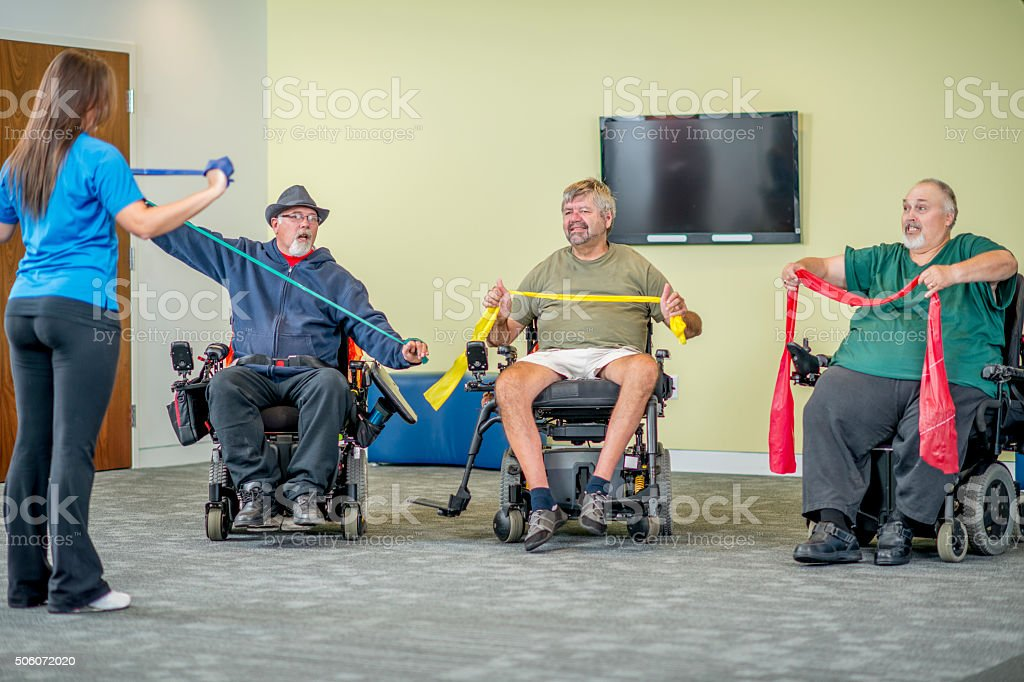 Disabled Adults Taking a Fitness Class stock photo