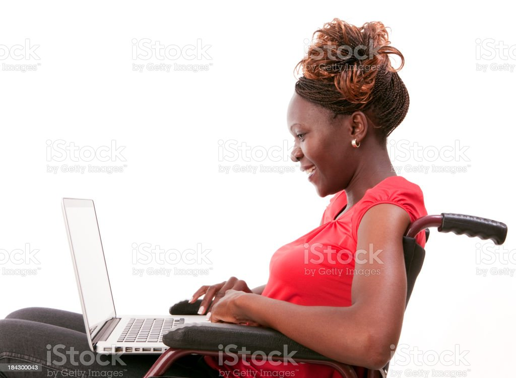 Disabled African woman using laptop royalty-free stock photo