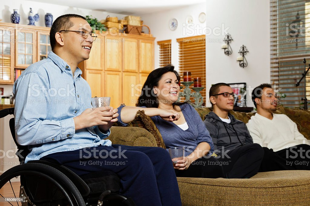 Disabled Asian man at home with his family royalty-free stock photo