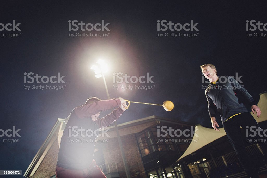 Disabled Boy Doing Hammer Throw stock photo