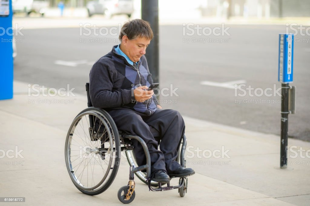 Disabled Business Man in the City stock photo