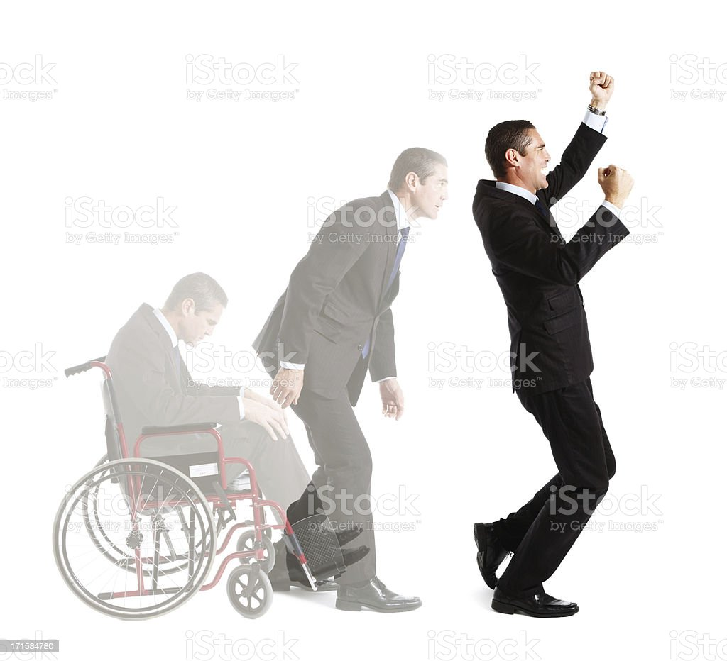 Disabled businessman rises triumphantly from wheelchair in composite shot stock photo