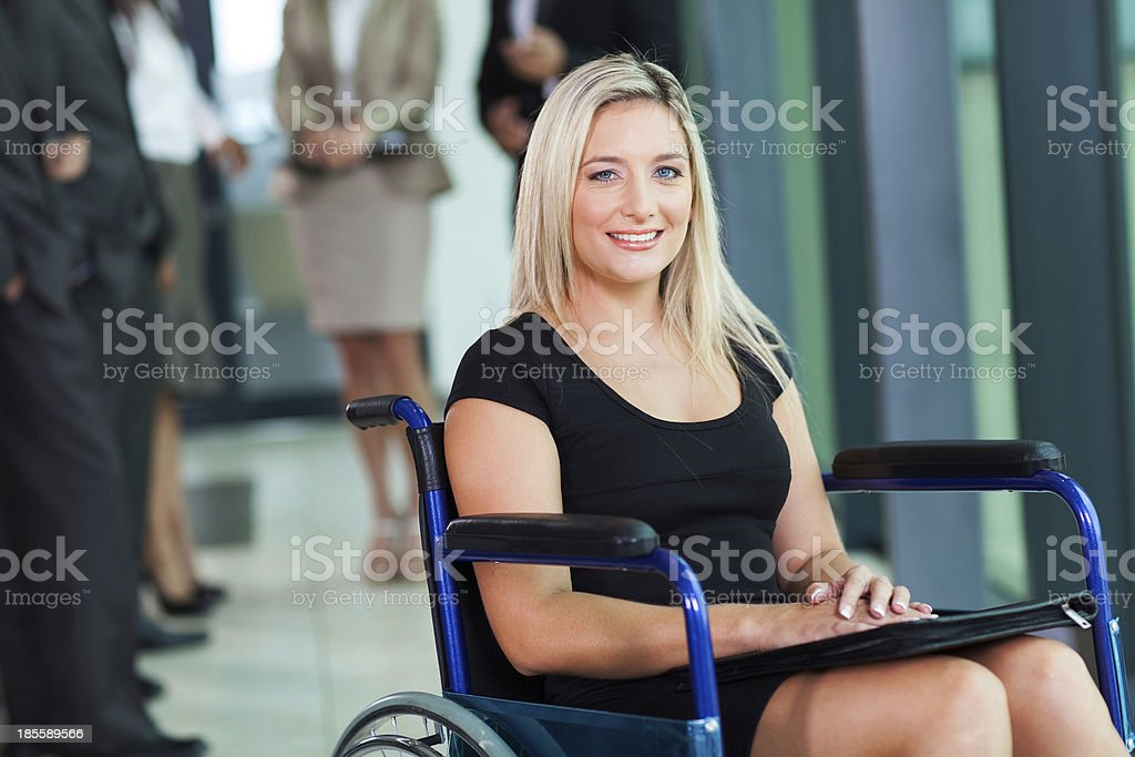 disabled businesswoman sitting in a wheelchair stock photo
