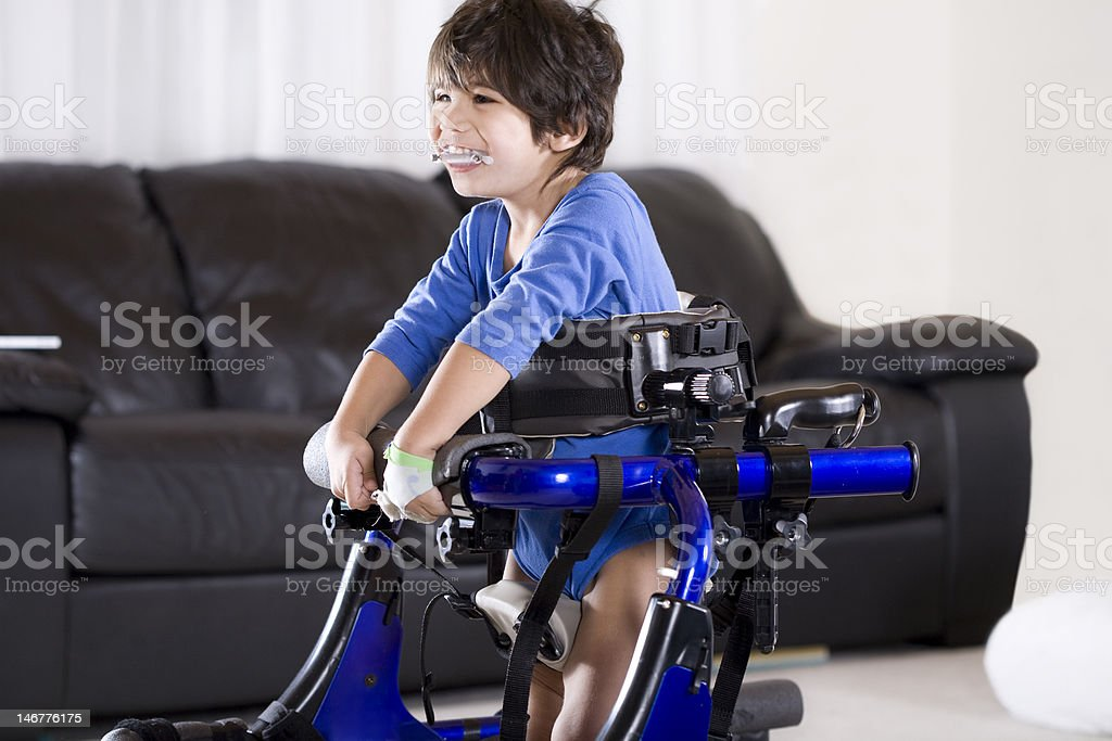 Disabled child in walker stock photo