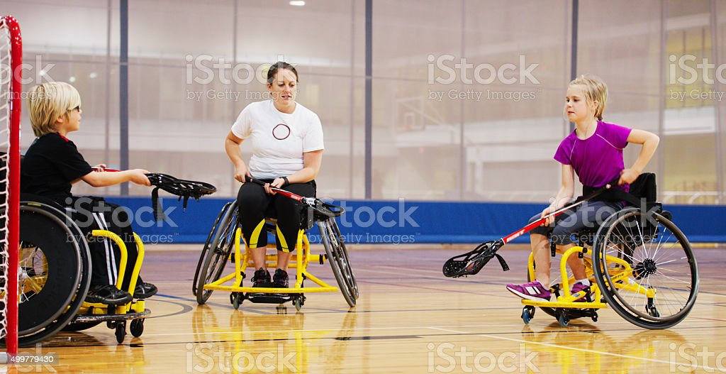 Disabled Children Being Coached at the Gym stock photo