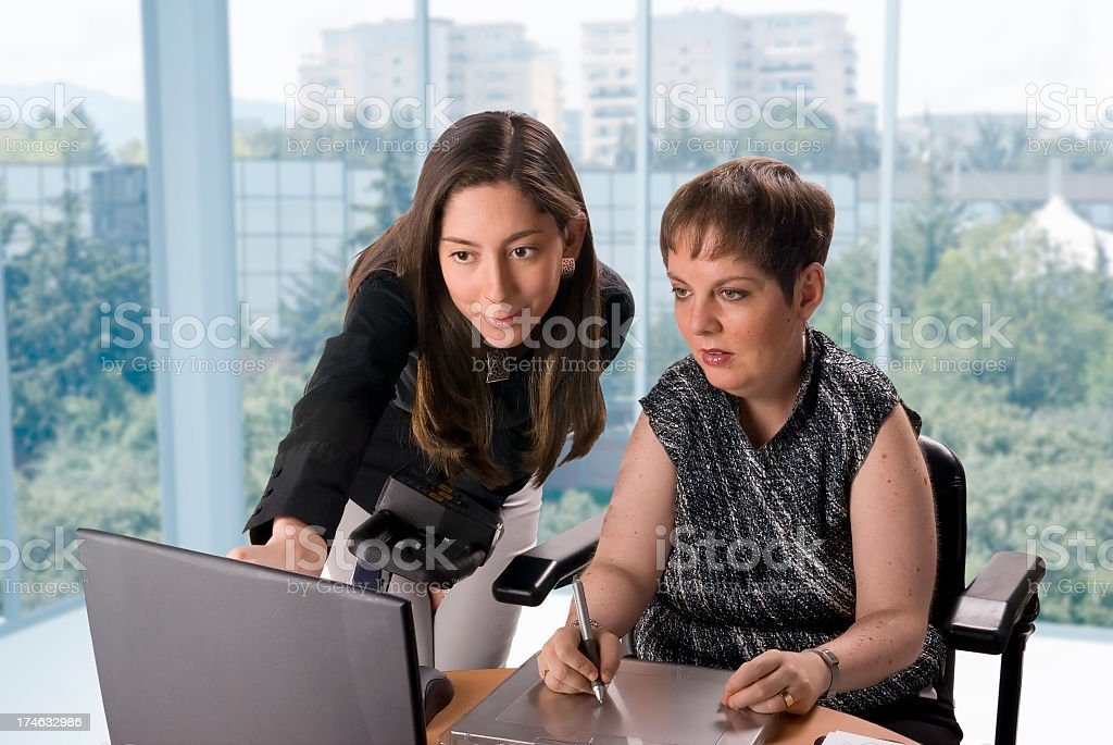 Disabled designer and co-worker royalty-free stock photo