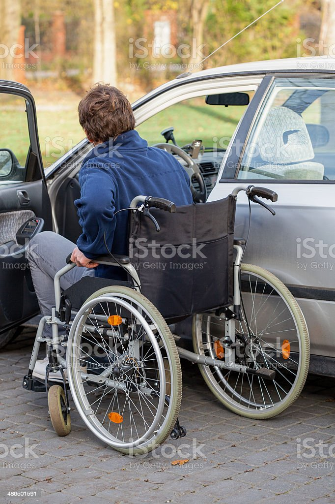 Disabled driver next his car stock photo