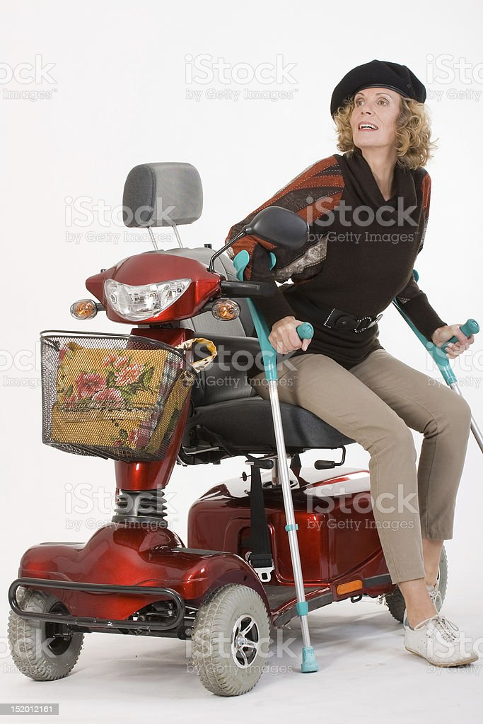 Disabled elderly woman with crutches stock photo