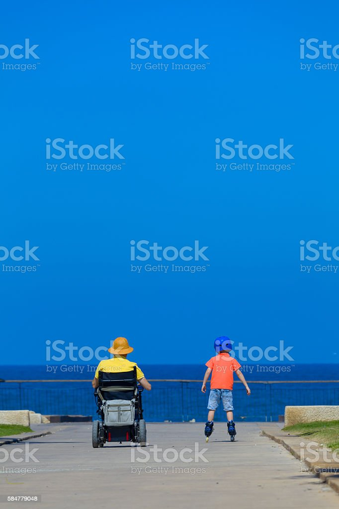 Disabled Father play with his little son stock photo