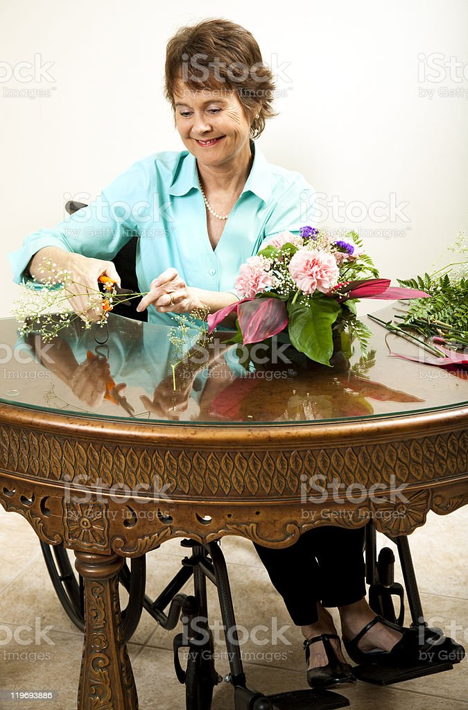 Disabled Florist Trims Babys Breath royalty-free stock photo