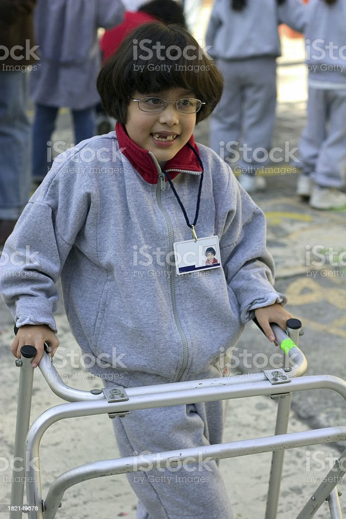 disabled girl in uniform with walker royalty-free stock photo