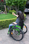 Disabled girl playing outdoors
