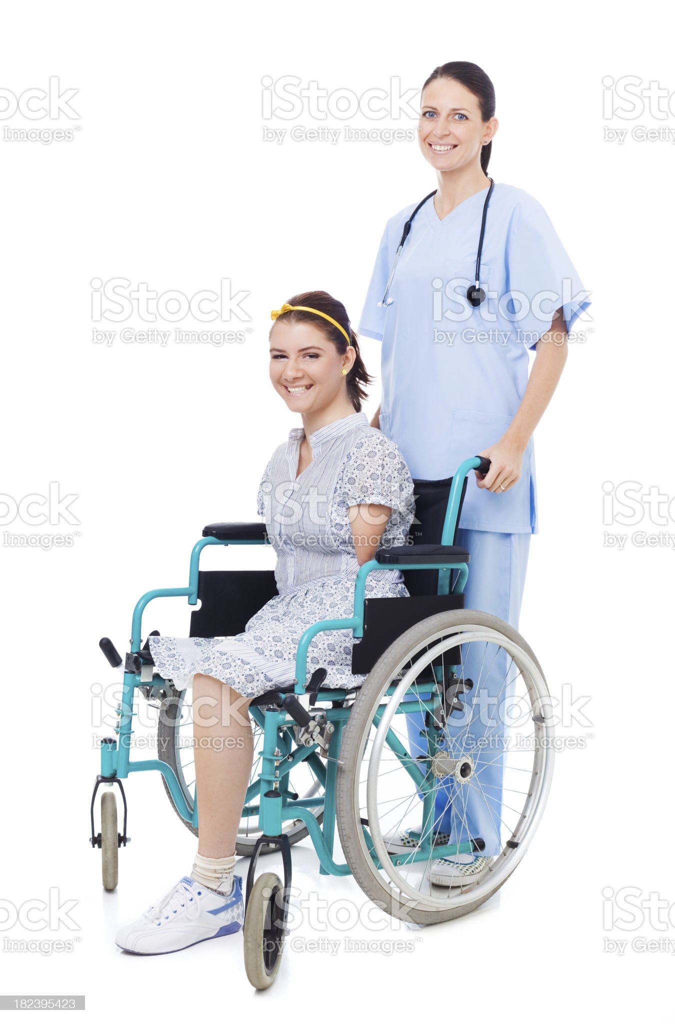 Disabled Girl With Friendly Nurse, Studio Portrait royalty-free stock photo