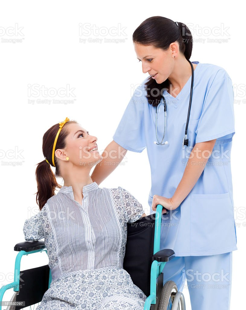 Disabled Girl With Friendly Nurse, Studio Shot royalty-free stock photo