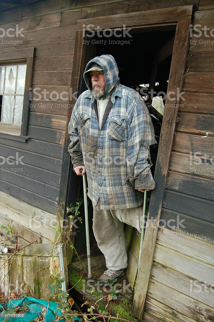 Disabled Man and His Hovel royalty-free stock photo