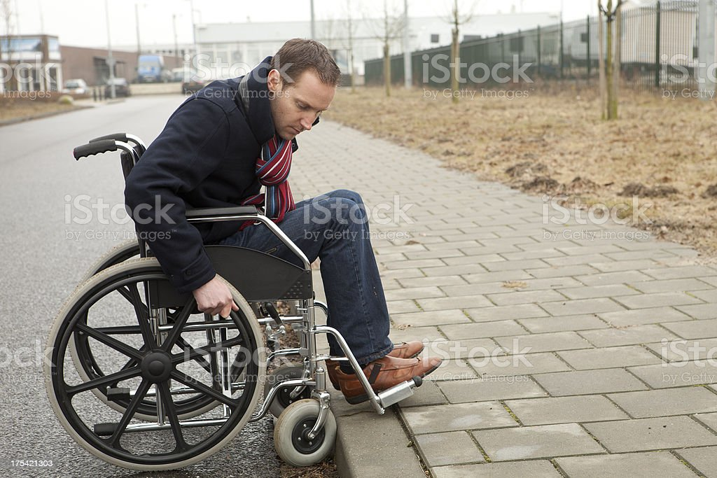 Disabled Man at Foot of pavement royalty-free stock photo
