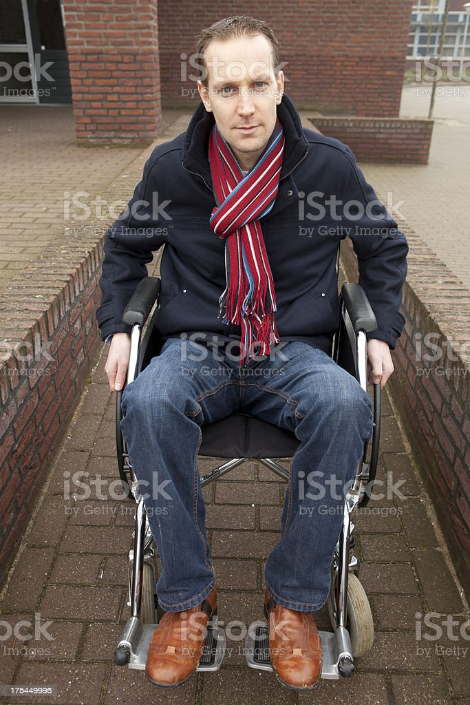 Disabled Man at Foot of Stairs, independent stock photo
