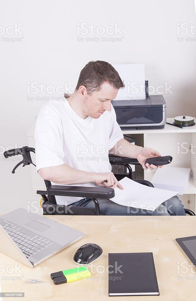 disabled man at work royalty-free stock photo